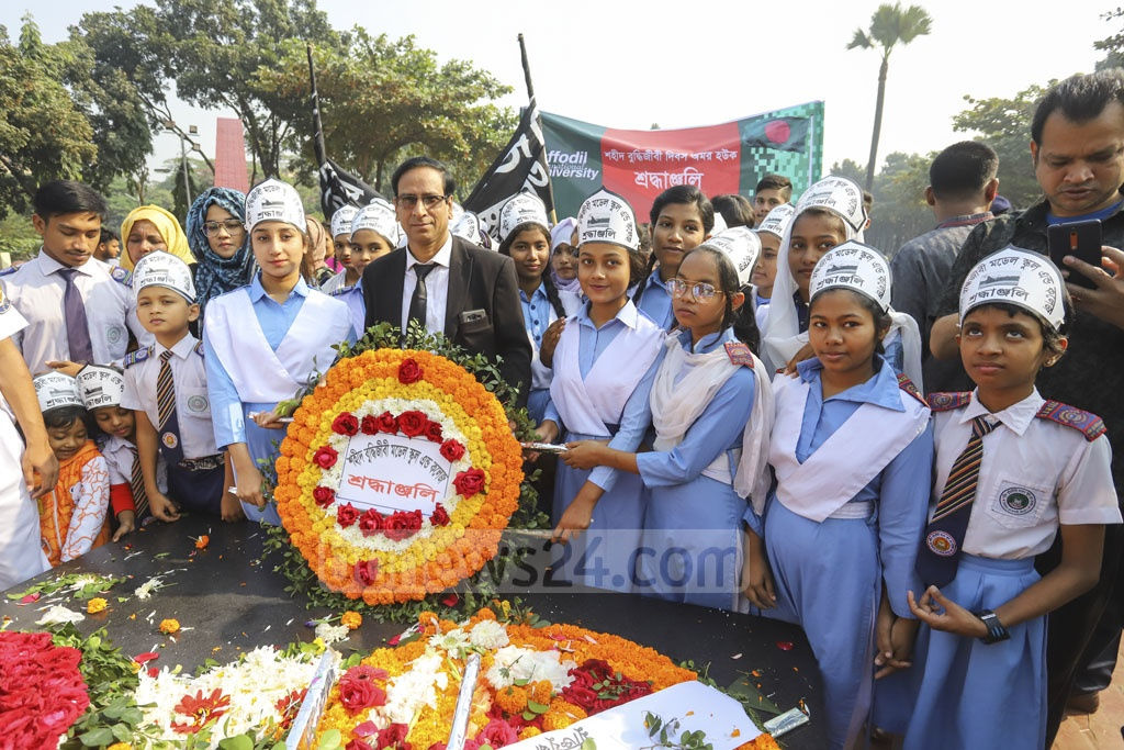 Students from different educational institutes pay tribute to the martyred intellectuals at the Martyred Intellectuals Memorial at Mirpur in Dhaka on Satuday. Photo: Asif Mahmud Ove