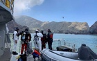 Members of a dive squad conduct a search during a recovery operation around White Island, which is also known by its Maori name of Whakaari, a volcanic island that fatally erupted earlier this week, in New Zealand, Dec 13, 2019.  REUTERS