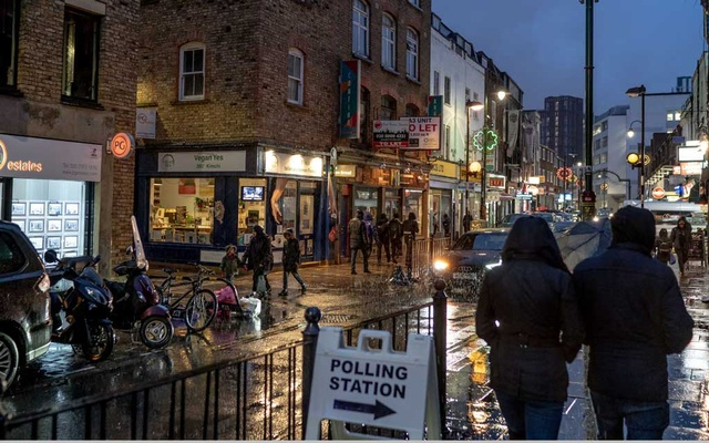 A sign outside a polling station in east London on Thursday, Dec 12, 2019. Britons are voting in pubs, churches, schools and other polling stations for their next government on Thursday, an important moment for the deeply divided country. The New York Times
