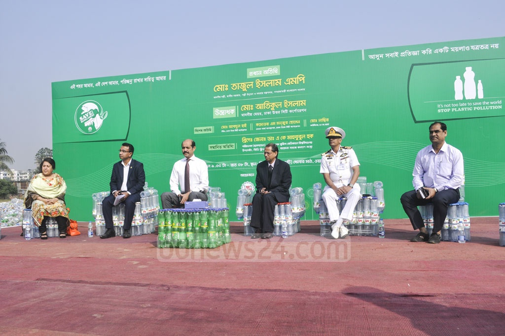 Guests sitting on seats made of empty plastic bottles at the exhibition organised by BD Clean at Mohakhali's T&T Colony playground in Dhaka on the eve of Victory Day. Photo: Asif Mahmud Ove