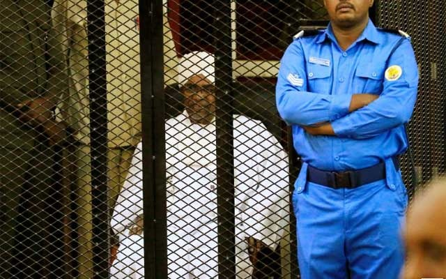 Sudanese former president Omar Hassan al-Bashir sits inside a cage during the hearing of the verdict that convicted him of corruption charges in a court in Khartoum, Sudan. Dec 14, 2019. REUTERS/Mohamed Nureldin Abdallah