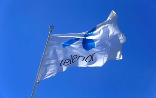 FILE PHOTO: Telenor flag flutters next to the company's headquarters in Fornebu, Norway, June 1, 2017. Reuters