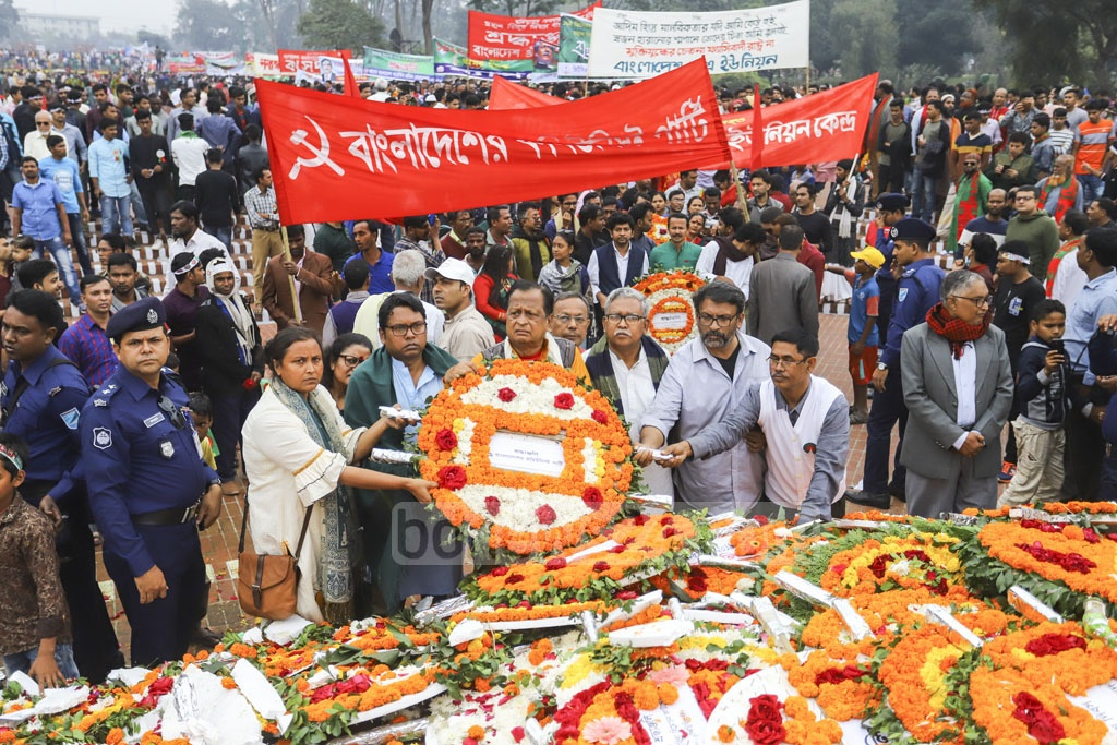 The Communist Party of Bangladesh pays its respects to the martyrs of 1971 at the National Memorial on Monday. Photo: Asif Mahmud Ove