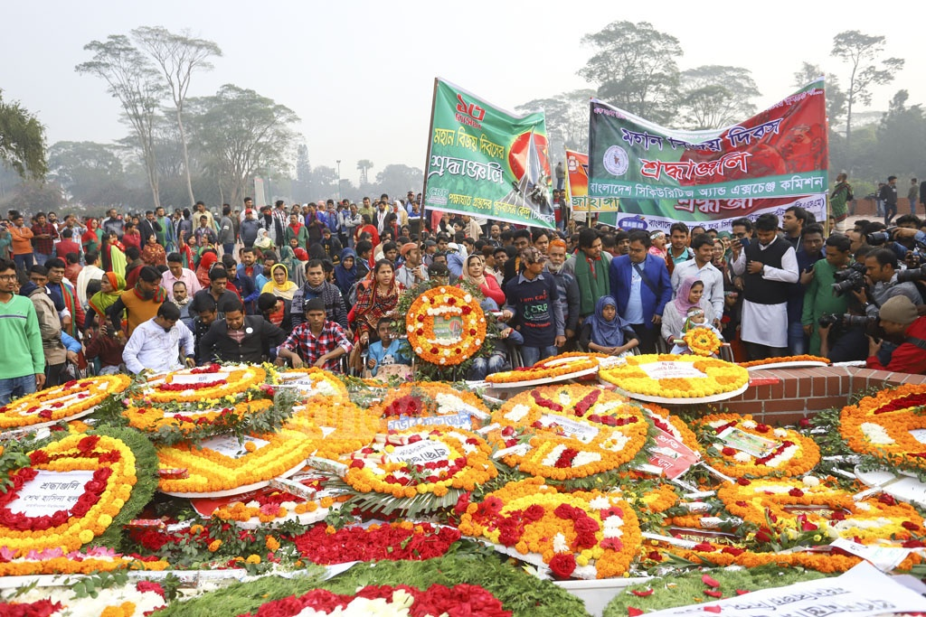 The Centre for the Rehabilitation of the Paralysed or CRP pays its respects to the martyrs of 1971 at the National Memorial on Monday. Photo: Asif Mahmud Ove