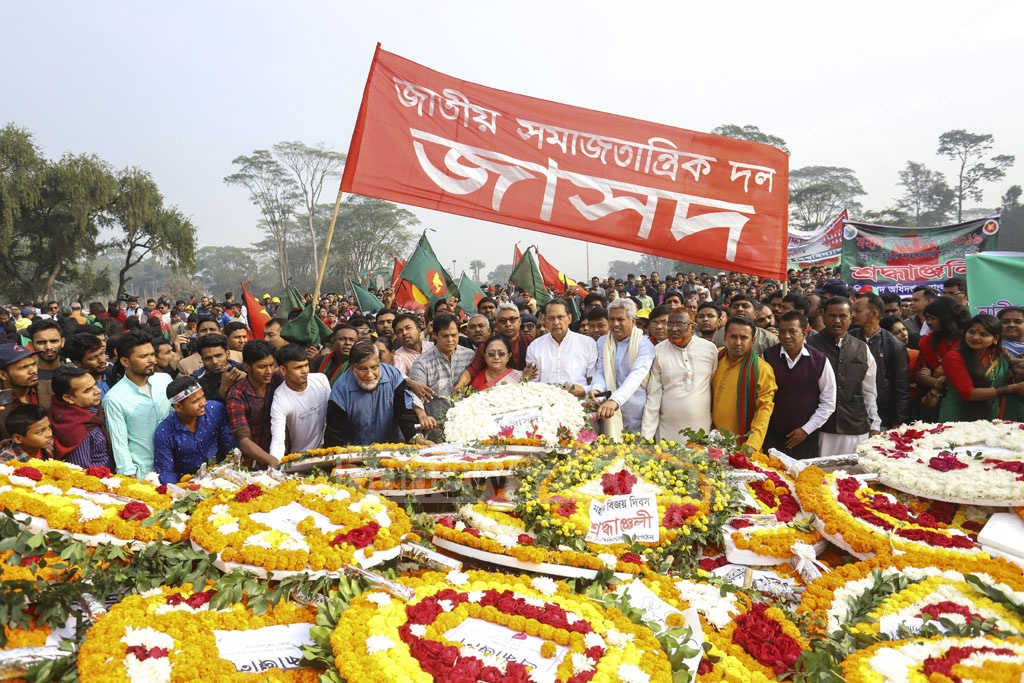 The Jatiya Samajtantrik Dal pays its respects to the martyrs of 1971 war at the National Memorial on Monday. Photo: Asif Mahmud Ove