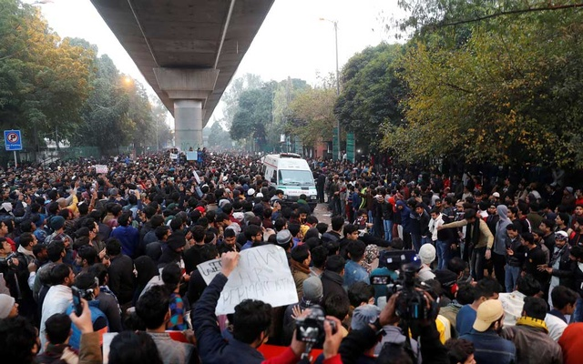 Demonstrators make way for an ambulance during a protest against a new citizenship law, outside Jamia Millia Islamia university in New Delhi, India, December 16, 2019. Reuters