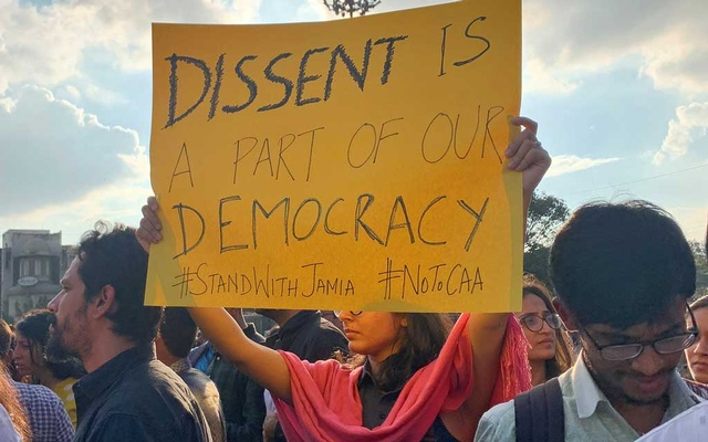 A demonstrator displays a placard during a protest to show solidarity with the students of New Delhi's Jamia Millia Islamia university after police entered the university campus on Sunday following a protest against a new citizenship law, in Bengaluru, India, December 16, 2019. Reuters