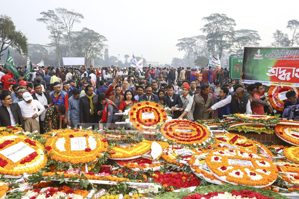 Several organisations pay their respects to the martyrs of 1971 at the National Memorial on Monday. Photo: Asif Mahmud Ove