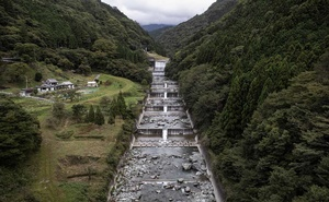 The Iya river, which runs through the village of Nagoro — surrounded by mountains covered with cedar — on the island of Shikoku in Japan, Oct 6, 2019. The village is down to just over two dozen residents, all of them adults. As the country's population shrinks and ages, rural areas are emptying out. The New York Times