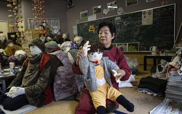 Tsukimi Ayano, 70, works on one of her dolls, in Nagoro, Japan, Oct 7, 2019. Ayano and her friends have made some 350 life-size dolls — made of wood and wire frames, stuffed with newspapers and dressed in old clothes donated from across Japan — in various scenes evoking the real people who once populated their village. The New York Times