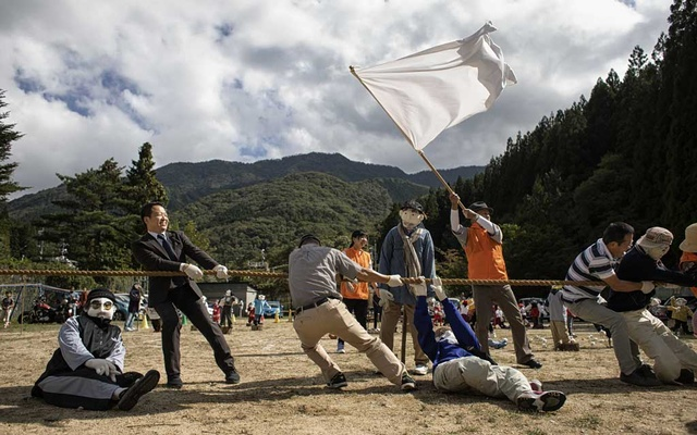 A tug-of-war, with both doll and living participants, during a day on which the village recreated what was once an annual sports festival day, in Nagoro, Japan, Oct 6, 2019. The New York Times