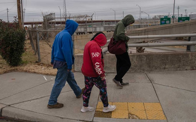 Rose, centre, who asked to be identified by her nickname, with her boyfriend and another young man, all homeless, walk to a drop-in youth centre in Tulsa, Okla, on Nov 21, 2019. The New York Times