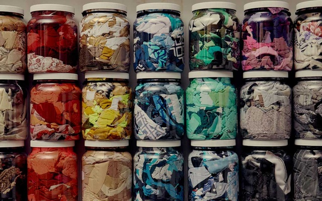 Jars of tiny clothing scraps organized by color on a shelf in the back of the Zero Waste Daniel store in Brooklyn on Nov 6, 2019. The New York Times