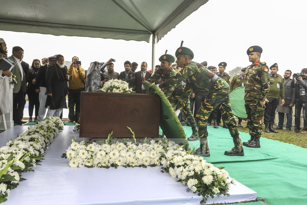 Deputy Military Secretary Col Saifullah placing a wreath on Fazle Hasan Abed's coffin on behalf of Prime Minister Sheikh Hasina at the Dhaka's Army Stadium on Sunday.