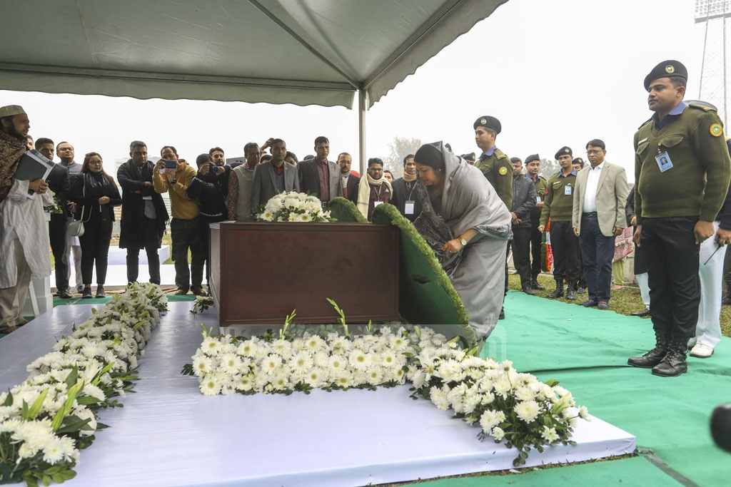 Speaker Shirin Sharmin Chaudhury placing a wreath on Fazle Hasan Abed's coffin at the Dhaka's Army Stadium on Sunday.