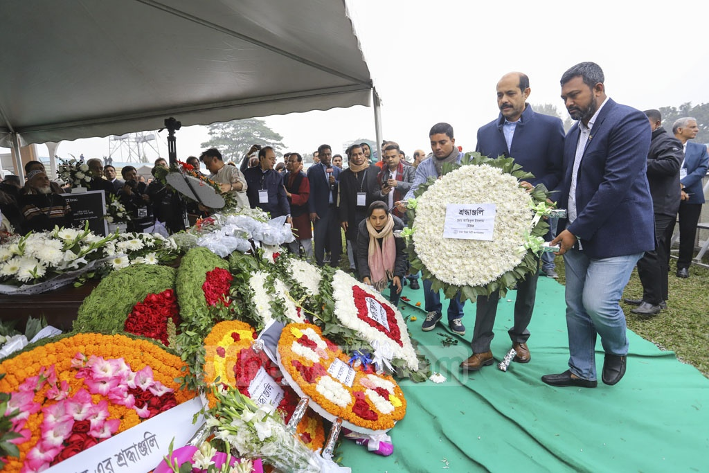 Dhaka North City Corporation Atiqul Islam placing a wreath on Fazle Hasan Abed's coffin at the Dhaka's Army Stadium on Sunday.