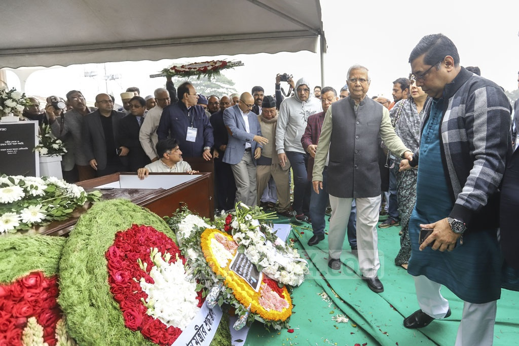 Nobel laureate Muhammad Yunus paying his final respects to Fazle Hasan Abed at the Dhaka's Army Stadium on Sunday.