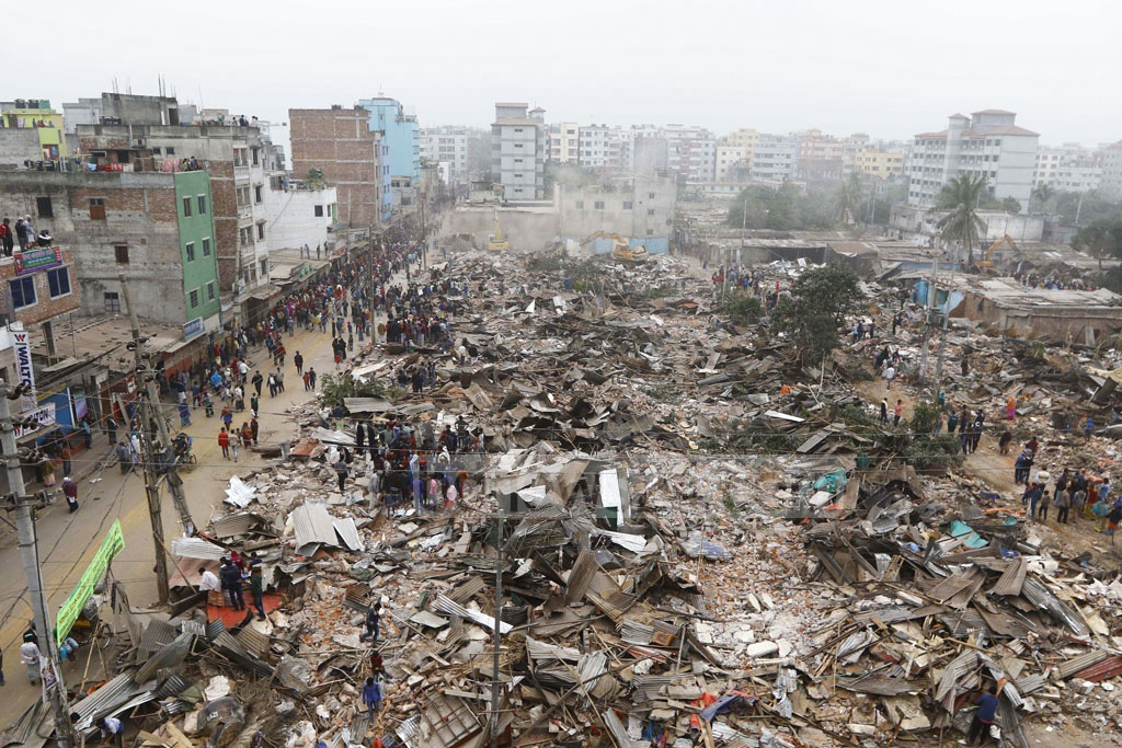 The Ministry of Land, Public Works Department and National Housing Authority conduct an eviction drive to recover 474 plots of Fazilatunnesa Waqf State in Dhaka's Rupnagar on Sunday.