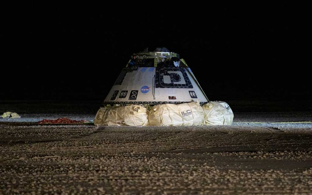 The Boeing CST-100 Starliner spacecraft, which had been launched on a United Launch Alliance Atlas V rocket, is seen after its descent by parachute following an abbreviated Orbital Flight Test for NASA's Commercial Crew Programme in White Sands, New Mexico, US December 22, 2019. NASA