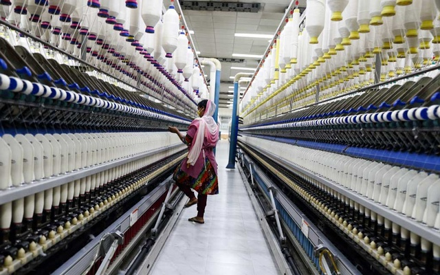 Spinning yarn inside a DBL factory, where many H&M products are manufactured, in Dhaka, Bangladesh in October 2019. The Swedish retailer now lets customers know where nearly every garment it sells is made. Is that enough? (Fabeha Monir/The New York Times)