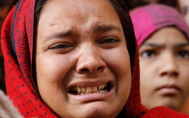 Sister of Mohsin, who died during clashes with police following protests against a new citizenship law, cries outside their house in Meerut, in the northern state of Uttar Pradesh, India, December 24, 2019. Reuters