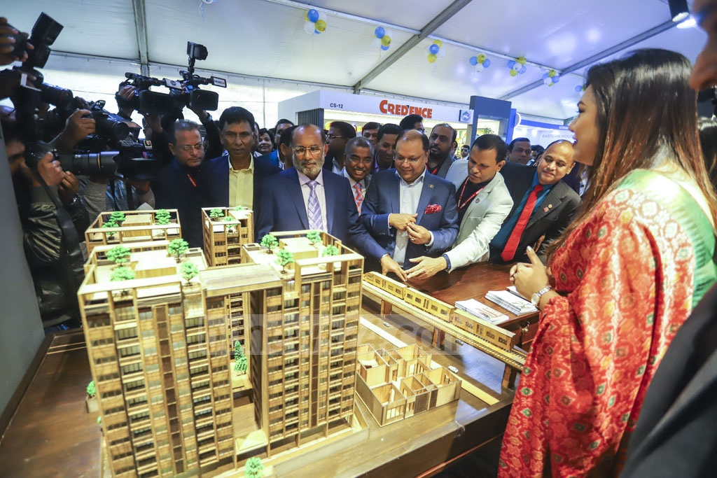 Housing and Public Works Minister SM Rezaul Karim visits several stalls after inaugurating a five-day winter fair at the Bangabandhu International Conference Centre in Dhaka on Tuesday. Photo: Asif Mahmud Ove