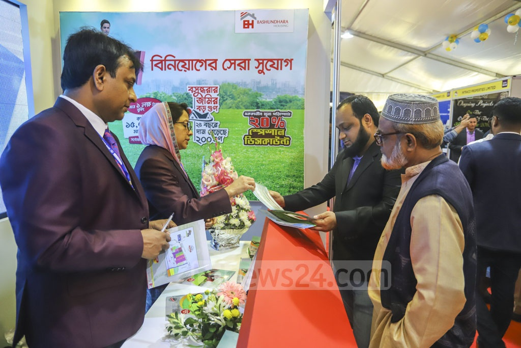 People visit a stall at the winter fair organised by REHAB at the Bangabandhu International Conference Centre in Dhaka on Tuesday. Photo: Asif Mahmud Ove