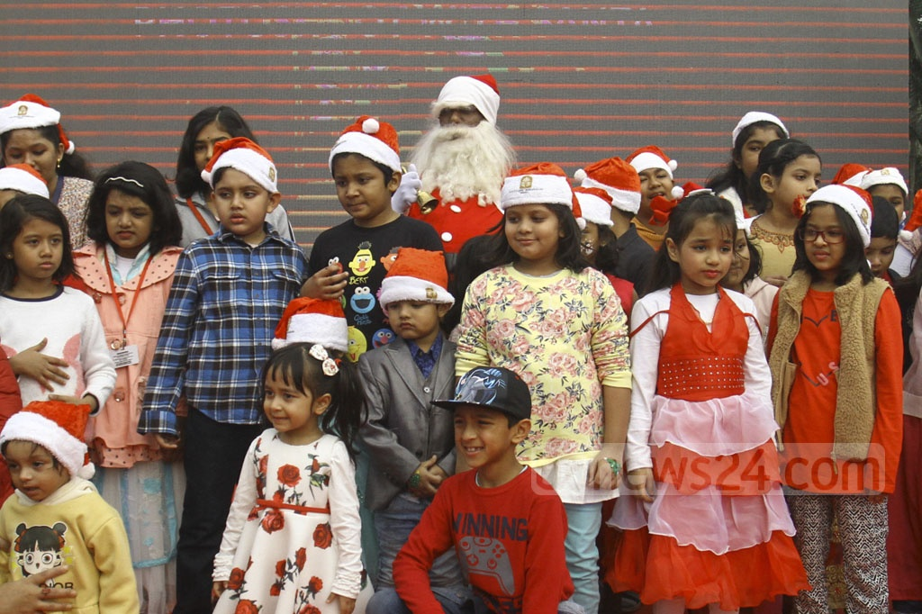 Santa Claus poses with children at the Pan Pacific Sonargaon Hotel in Dhaka during Christmas celebrations.