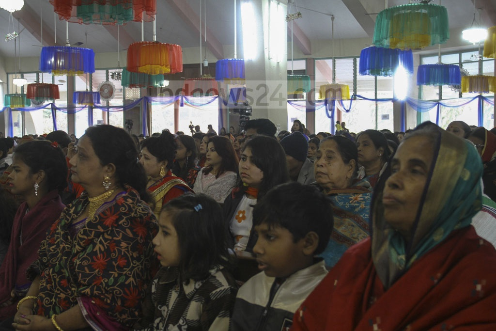 Children join prayer services with elders during Christmas celebrations at Holy Rosary Catholic Church at Dhaka's Farmgate.
