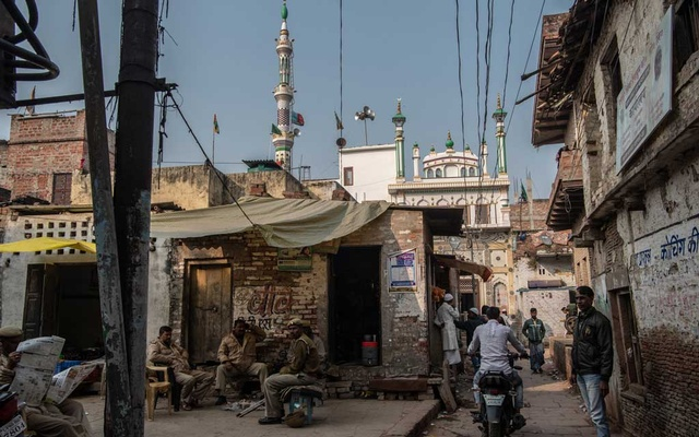 Police outside a mosque in Varanasi, India on Sunday, Dec 22, 2019, where protests against a contentious citizenship law recently turned violent. The New York Times