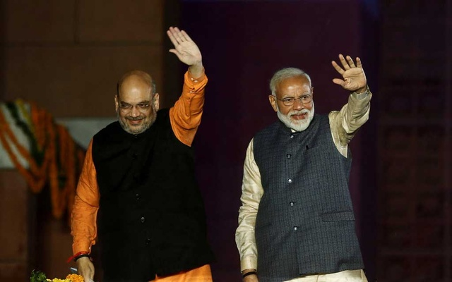 FILE PHOTO: Indian Prime Minister Narendra Modi and Bharatiya Janata Party (BJP) President Amit Shah wave towards their supporters after the election results at party headquarters in New Delhi, India, May 23, 2019. REUTERS