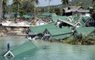 Submerged buildings are seen near the pier at Ton Sai Bay in Thailand's Phi Phi island, Dec 28, 2004 after a tsunami hit the area. REUTERS/FILE