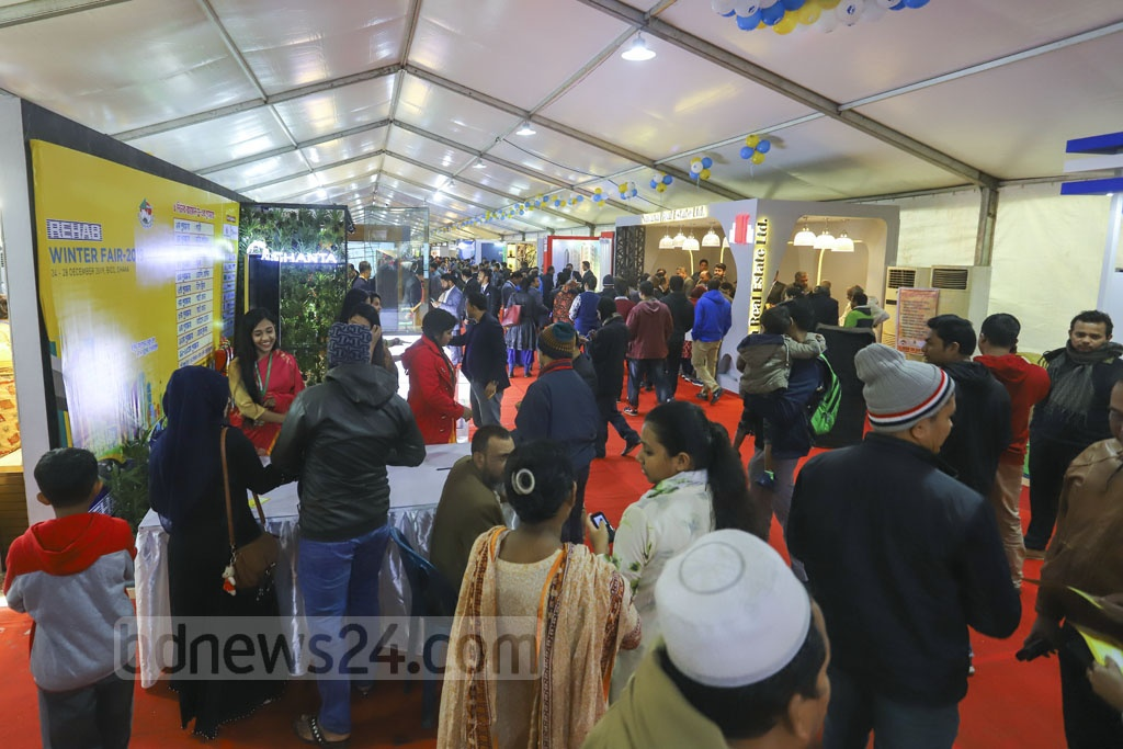Visitors browse the stalls in a five-day winter housing fair organised by REHAB on the fourth day on Friday at the Bangabandhu International Conference Centre in Dhaka. Photo: Asif Mahmud Ove
