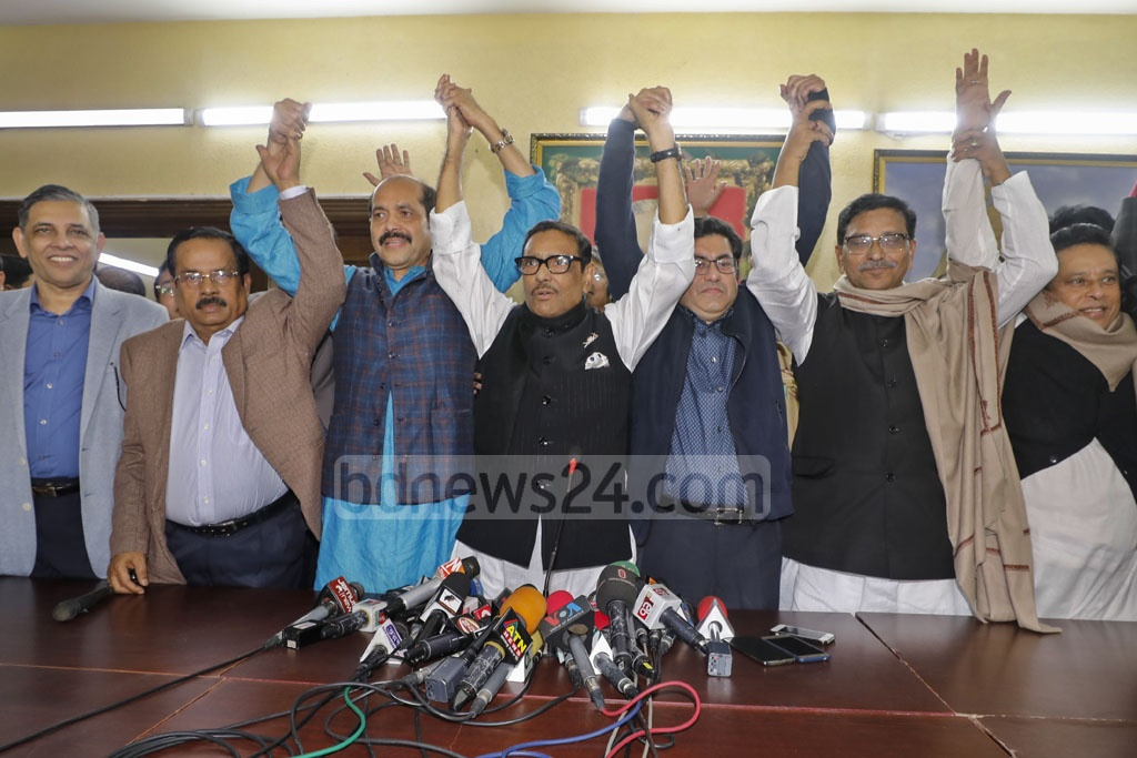 Awami League General Secretary Obaidul Quader greets Atiqul Islam and Sheikh Fazle Noor Taposh after announcing their names as mayoral candidates for Dhaka city polls on Sunday.