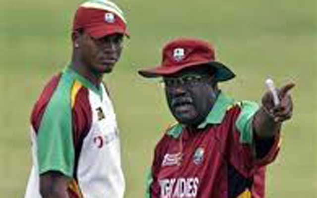 File Photo: Former West Indies captain and current team manager Clive Lloyd (R) gestures as his team player Marlon Samuels watches during a practice session in Montego Bay March 7, 2007. Reuters
