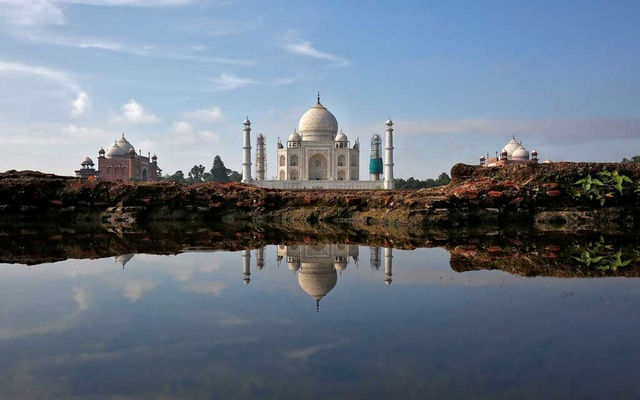 The Taj Mahal is reflected in a puddle in Agra, India Aug 9, 2016. REUTERS/FILE