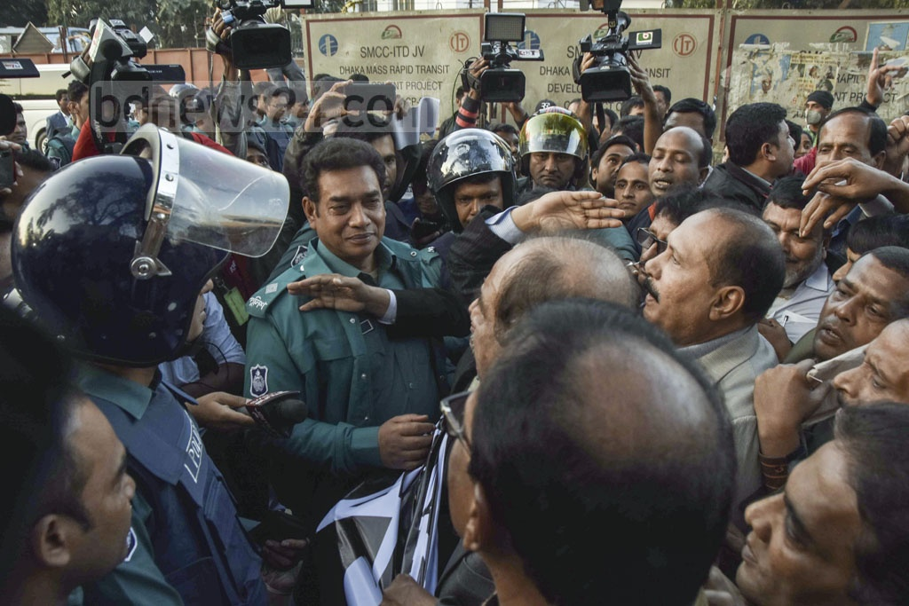 Police stopped Jatiya Oikya Front activists after they took out a procession outside the National Press Club in Dhaka on Sunday in protest against 'irregularities' in the Dec 30, 2018 general election on the eve of the first anniversary of the polls.