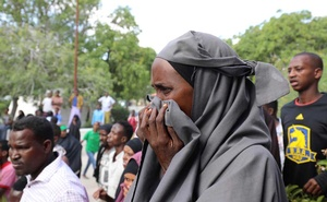A Somali woman reacts at the scene of a car bomb explosion at a checkpoint in Mogadishu, Somalia Dec 28, 2019. REUTERS