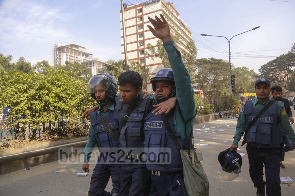 Colleagues taking away a policeman injured in clashes with leftists during an anti-government 'black flag' march in Dhaka on Monday. Photo: Mahmud Zaman Ovi