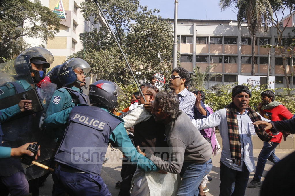 Saiful Haque, the general secretary of the Revolutionary Worker Party, and police wrangling during an anti-government 'black flag' march in Dhaka on Monday. Photo: Mahmud Zaman Ovi