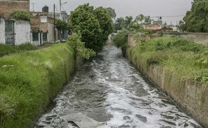 One of the canals that cuts through a residential area and empties into the Santiago River in the town of El Salto, in Jalisco, Mexico, Sept 11, 2019. The New York Times
