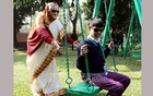 Prime Minister Sheikh Hasina pushing a boy on a swing at the Ganabhaban on Tuesday after a group of childredn came for text books of the new year.
