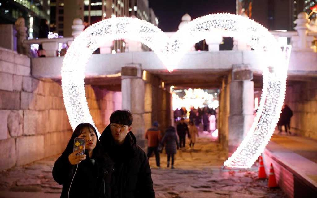 A couple poses for a selfie during New Year s Eve in Seoul, South Korea. REUTERS