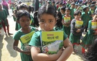 Students of Bhum South Government Primary School in Manikganj's Singair received new textbooks on the first day of the year 2020 on Wednesday as the government kicked off the festival to distribute the books for free across Bangladesh. Photo: Mostafigur Rahman