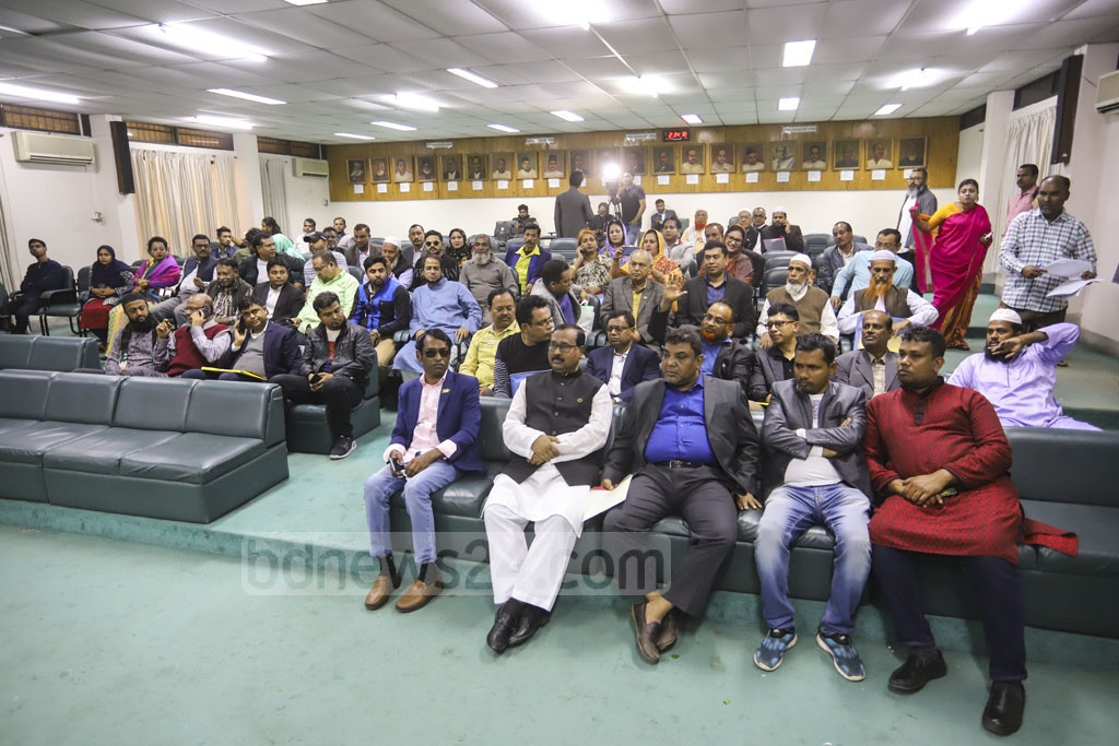 Candidates for the councillor posts gather at the office of the Dhaka North City Corporation returning officer during the scrutiny of nomination papers on Thursday to hear the names of the valid aspirants. Photo: Asif Mahmud Ove