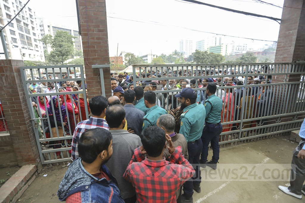Supporters of the Dhaka North City Corporation mayoral candidates gather in front of the returning officer's office during the scrutiny of nomination papers on Thursday. Photo: Asif Mahmud Ove