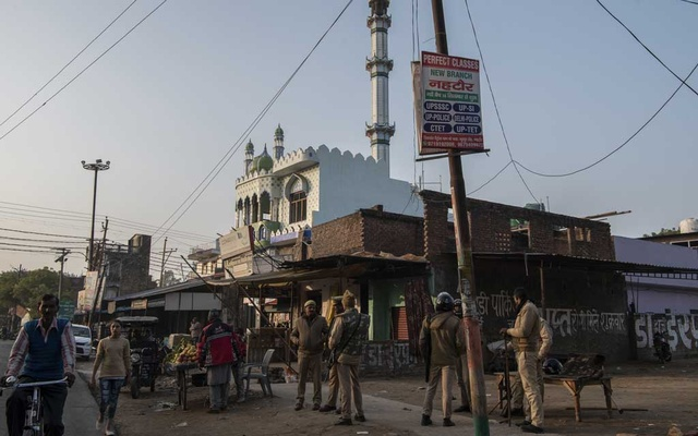 Police officers stationed outside a mosque in Nehtaur in the Uttar Pradesh state of India, Dec 24, 2019. The New York Times