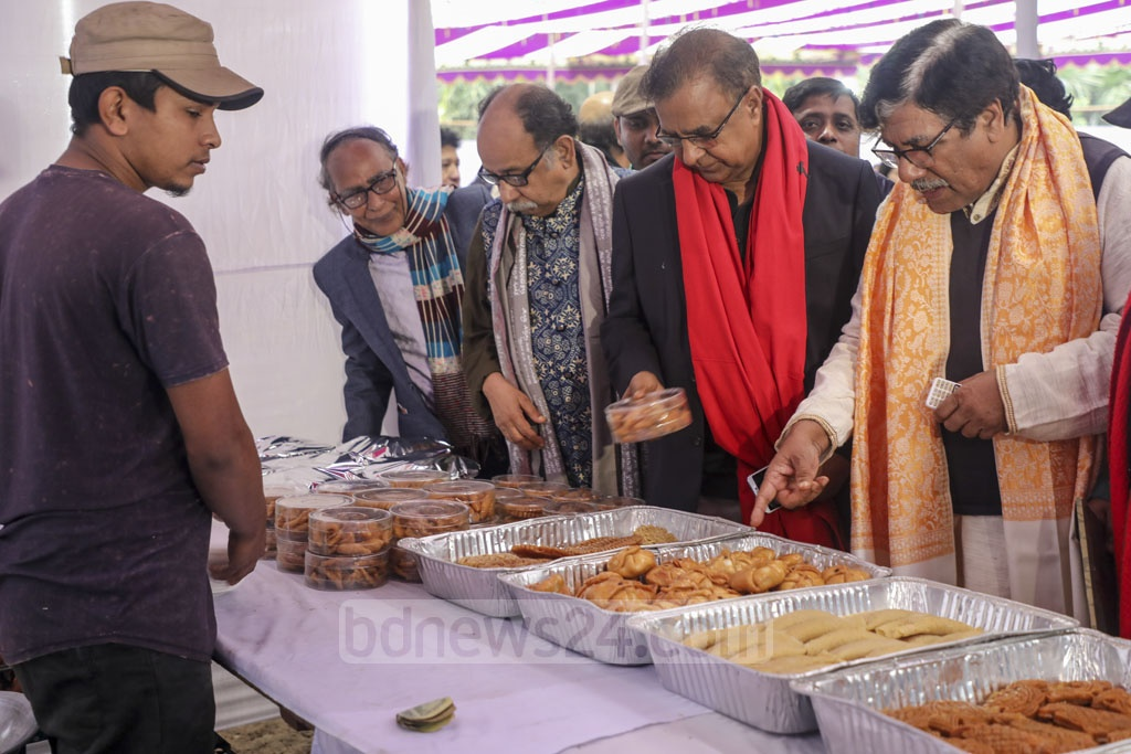 Guests visit a winter fair at the Bangla Academy premises in Dhaka after inauguration on Saturday. Photo: Mostafigur Rahman