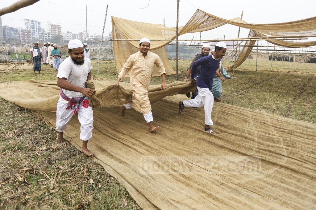 Preparations are underway for Bishwa Ijtema on the bank of the Turag River at Gazipur's Tongi on Sunday. Photo: Asif Mahmud Ove