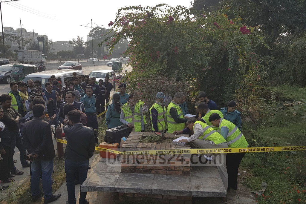 Members of police's Criminal Investigation Department, or CID, collecting evidence from the crime scene in the capital's Kurmitola, where a second-year undergrduate student of Dhaka University was raped on Sunday.
